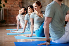 Group of people doing yoga exercises at studio royalty free stock images