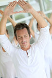 Group of people doing yoga Royalty Free Stock Photos