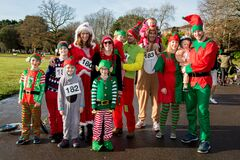 Group of people dressed as elves Stock Images