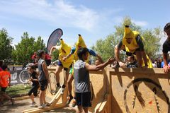 Group of people dresssed as bananas jumping Stock Photo