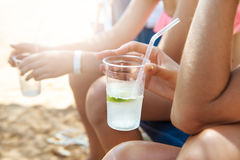 Group of people drinking cocktails on the beach Royalty Free Stock Photography