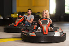 Group Of People Driving Go-Kart Karting Race stock images