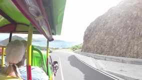 Group of people is driving to the beach through the tunnel enjoying gorgeous view from the hills on st. kitts island. Hd stock video footage