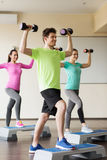 Group of people with dumbbells and steppers Stock Photography