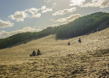 Group of People at the Dunes of Carilo royalty free stock photo
