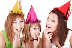 Group people eat cake. Group people in party hat eat cake. Isolated stock photography