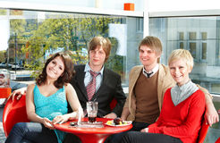 Group people eating  in cafe. Royalty Free Stock Photos