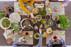 Group of people eating dinner. Group of people sitting beside wood table while eating dinner Stock Images