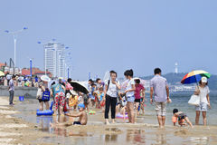 Group of people enjoy activities on the beach, Yantai, China Royalty Free Stock Photography