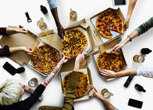 Group of people enjoy the italian cuisine pizza. Portrait royalty free stock photo