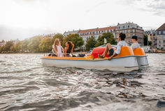 Group of people enjoying boating in the lake Stock Photos
