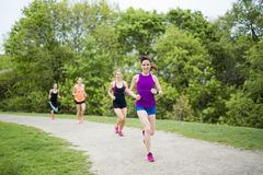 Group of people enjoying in the fitness having fun running outside royalty free stock photos