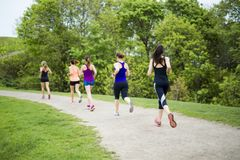 Group of people enjoying in the fitness having fun running outside royalty free stock image