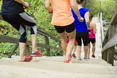 Group of people enjoying in the fitness having fun running outside royalty free stock images