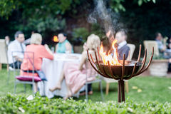 Group of people enjoying a garden party Stock Image