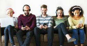 Group of people enjoying music streaming stock photography