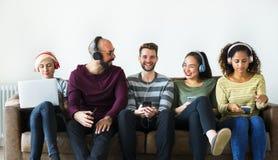 Group of people enjoying music streaming stock images