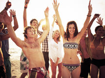 Group of people enjoying a summer beach party Stock Images