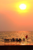 Group of people enjoying the sunset Royalty Free Stock Photo