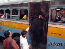A group of people entering the bus in Kolkata Royalty Free Stock Photography