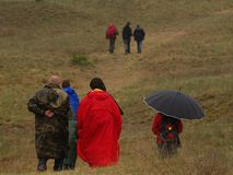 A group of people on an excursion during a bad weather Stock Image