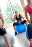 Group of people exercise with balls on yoga class Stock Photos