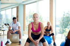 Group of people exercise with balls on yoga class Royalty Free Stock Image