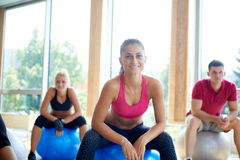 Group of people exercise with balls on yoga class Stock Photo