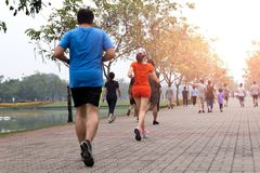Group of people exercise walking and jogging in the park. In morning royalty free stock image