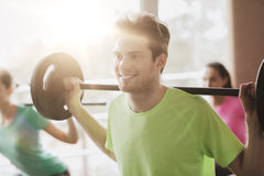 Group of people exercising with barbell in gym Stock Photography