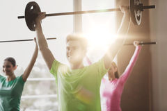 Group of people exercising with barbell in gym Royalty Free Stock Photography
