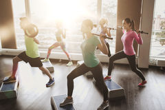 Group of people exercising with barbell in gym Royalty Free Stock Images