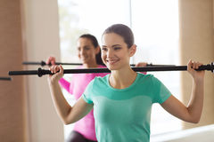 Group of people exercising with bars in gym Royalty Free Stock Image