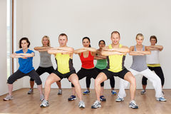 Group Of People Exercising In Dance Studio. Smiling To Camera Royalty Free Stock Photography