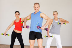Group Of People Exercising In Dance Studio With Weights. Smiling To Camera Royalty Free Stock Photos