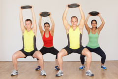 Group Of People Exercising In Dance Studio With Weights. Smiling To Camera Royalty Free Stock Image