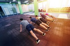 Group of people exercising in gym Royalty Free Stock Photo