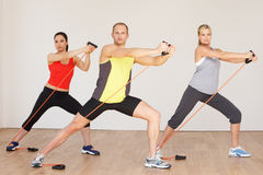 Group Of People Exercising In Gym. Looking To Camera Stock Photography