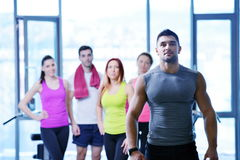 Group of people exercising at the gym Stock Photos