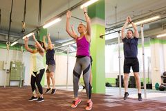 Group of people exercising and jumping in gym Royalty Free Stock Photos