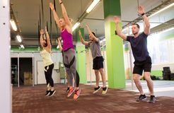 Group of people exercising and jumping in gym Stock Photo