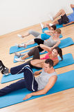 Group of people exercsning in a gym class Royalty Free Stock Image