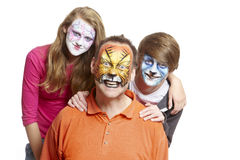 Group of people with face painting geisha girl wolf and tiger. Smiling on white background Stock Photography