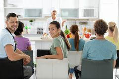 Group of people and female chef at classes. Group of people and female chef at cooking classes stock images