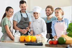 Group of people and female chef. At cooking classes stock photo