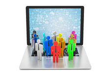Group of people figures on laptop Stock Image