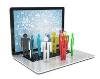 Group of people figures on laptop Royalty Free Stock Image