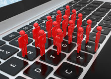 Group of people figures on laptop Royalty Free Stock Photography