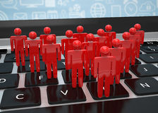 Group of people figures on laptop Royalty Free Stock Photo