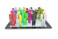 Group of people figures on tablet PC Stock Photo